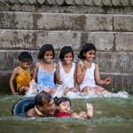 indian kids have fun in water of ganges river, Varanasi, India