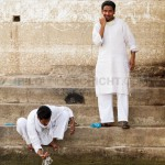two men washing at ganges river, Varanasi, India