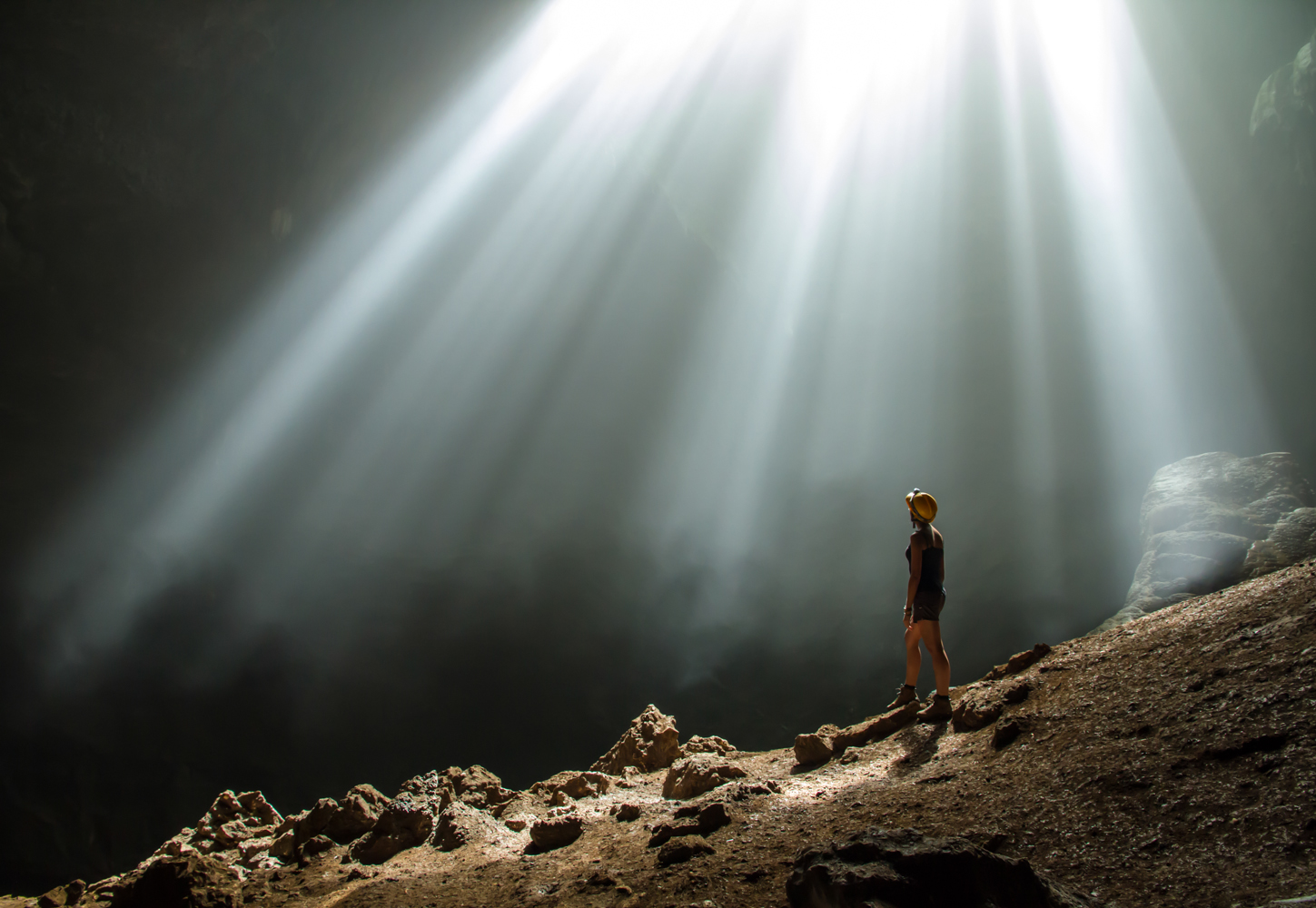 w28, woman watching up to the light of the jomblang cave, Java, Indonesia
